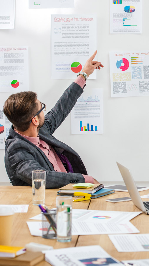 A man pointing at some statistics from their marketing campaigns