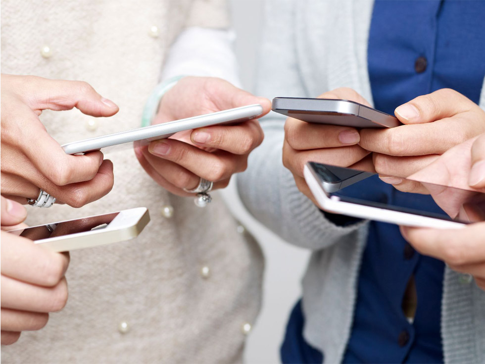 People using mobile phones in a circle